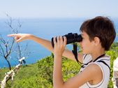 Child with binoculars — Stock Photo