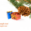 Branch of Christmas tree and gifts — Stock Photo