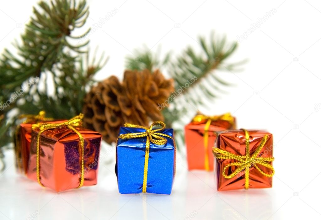Branch of Christmas tree and gifts isolated on white — Stock Photo #1694764