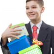 Schoolboy whith gifts — Stock Photo