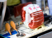 Macro detail of inductor with red wire — Stock Photo