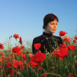 Stock Photo: Girl in poppy field