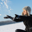 Girl plays with a snow — Stock Photo