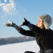 Girl plays with a snow — Stock fotografie