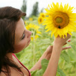 Royalty-Free Stock Photo: The young woman with sunflowers.