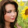 The young woman with sunflowers. — Stock Photo