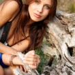 Girl near a tree root — Stock fotografie