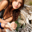Girl near a tree root — Stockfoto