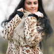 The young woman in a fur coat. — Stock Photo