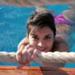 Brunette woman in the pool. - Foto de Stock