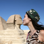 Young women kissing sfinks. — Stock Photo