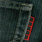 Black jeans with red label. — Stock Photo