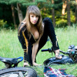 Stockfoto: Young women with black motorcycle.