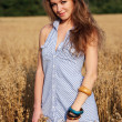 Woman in field of wheat. — Stock Photo