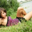 Sexy brunette in grass — Stock Photo