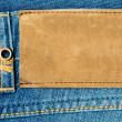 Blank leather label on blue jeans. — Stok fotoğraf