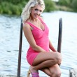 Blonde woman in the pink clothes — Stock Photo