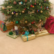 Presents under christmas tree - Stock Photo