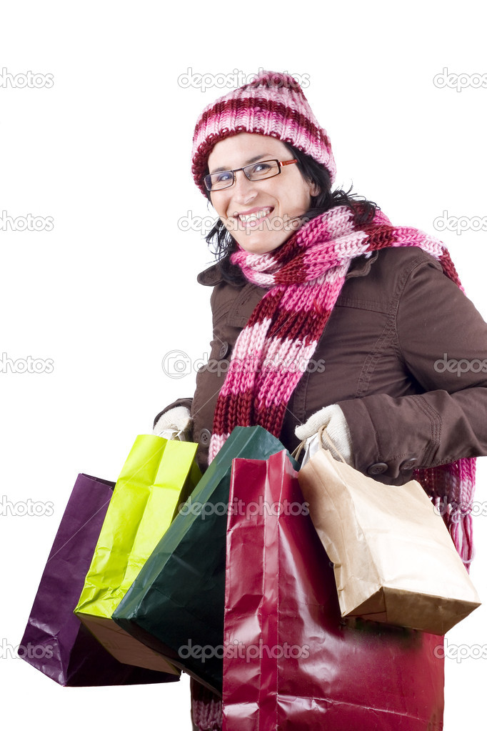 Consumerist Christmas girl with bags in a shopping day  Stock Photo #1022358