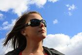The nice girl against the blue sky — Stock Photo