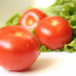 Red tomatos with salad - Stock Photo