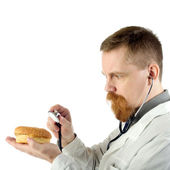 Doctor with hamburger — Stock Photo