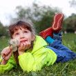 Little girl lying on the grass — Stock Photo #1036645