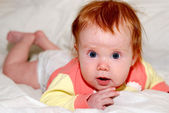Baby with wide open eyes — Stock Photo