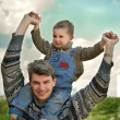 Stock Photo: Father and son (on the shoulders)