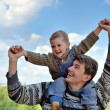 Royalty-Free Stock Photo: Father and son (on the shoulders)