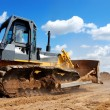 Bulldozer with raised blade in action — Stock Photo