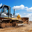 Bulldozer with raised blade in action — Stock Photo #1042761
