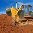 Close view of heavy bulldozer moving san — Stock Photo