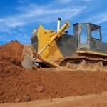 Heavy bulldozer moving sand in sandpit — Stock Photo #1042857