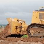 Small bulldozer blade in action — Stock Photo #1042916