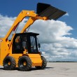 Skid steer loader bulldozer — Stock Photo #1042933