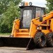 Skid steer loader bulldozer — Stock Photo #1042957