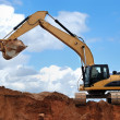 Stock Photo: Excavator with raised bucket