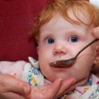 Baby Feeding with spoon. Close-up — Stock Photo