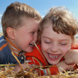 Laughing Boy and girl outdoors — Stock Photo #1049498