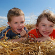 Smiling boy and girl outdoors — Stock Photo