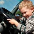 Smiling boy and steering wheel — Stock Photo #1049611