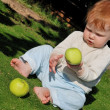Baby playing with apples — Stock Photo