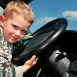 Joyful little boy at driver position in — Stock Photo #1049702