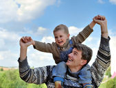 Father and son (on the shoulders) — Stock Photo
