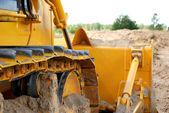 Bulldozer track in action — Stock Photo