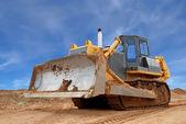 Heavy bulldozer with half raised blade i — Stock Photo