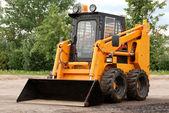 Skid steer loader bulldozer — Stock Photo