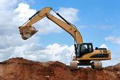 Excavator with raised bucket — Stock Photo