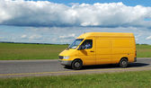 Yellow delivery truck — Stock Photo